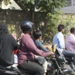 Yup, that's a family of four (and a single helmet) on a motorcycle.